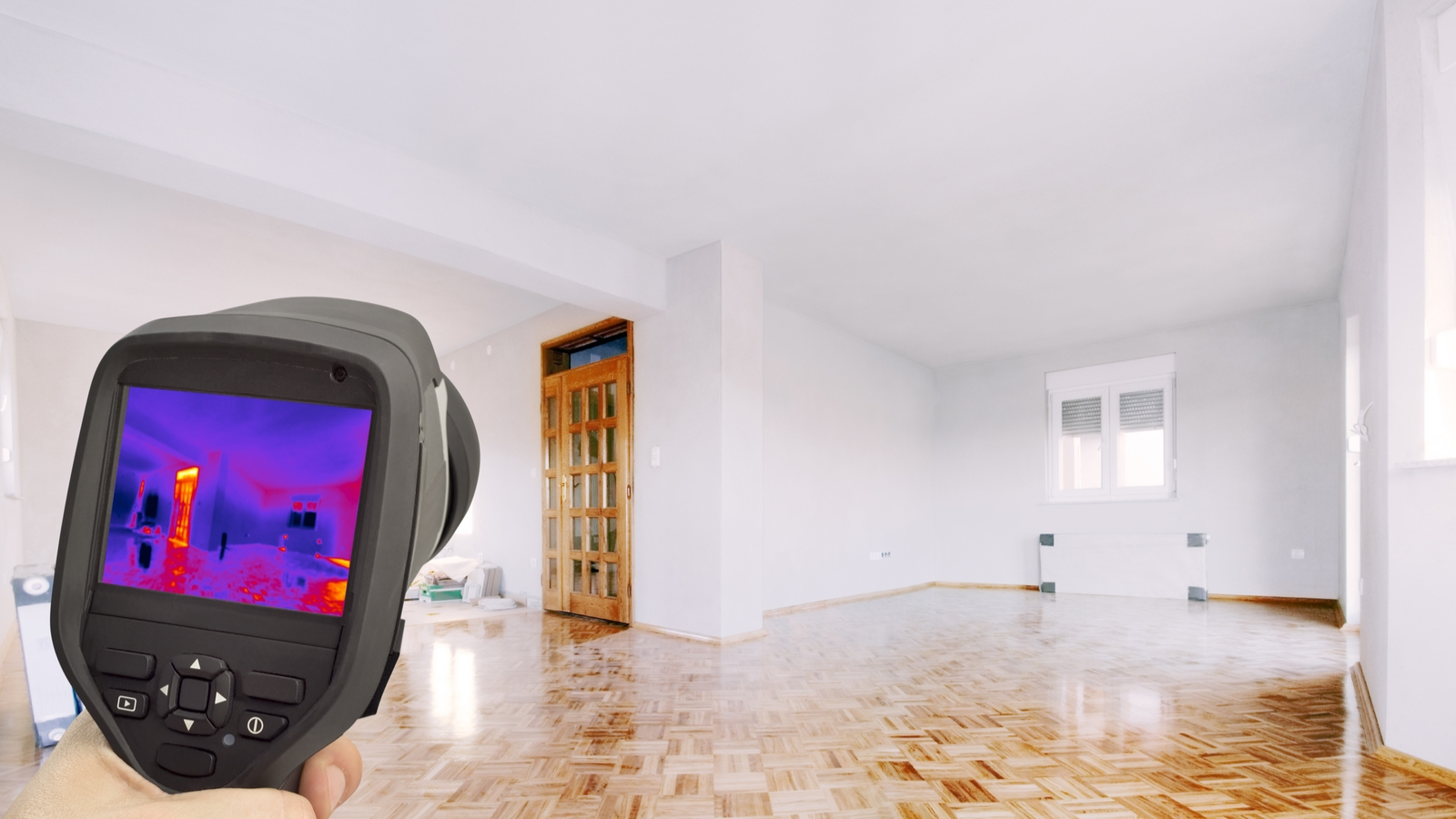 Thermal Image Camera Conducting Energy Audit in New Home